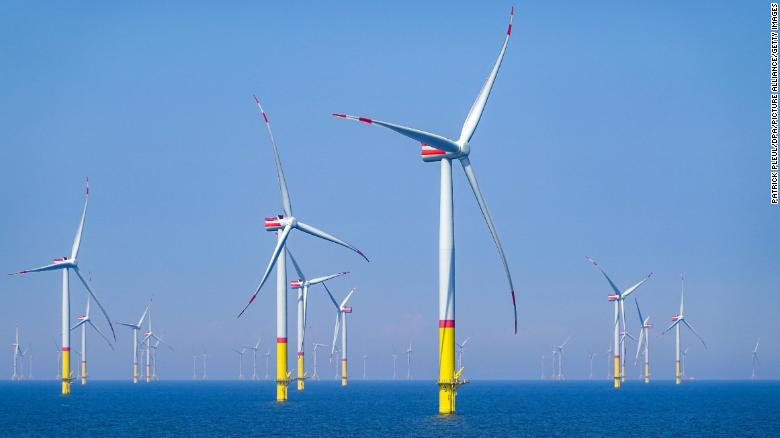 26 June 2020, Mecklenburg-Western Pomerania, Sassnitz: Wind turbines are located in the Baltic Sea between the islands of R??gen and Bornholm (Denmark). The wind farm, about 35 kilometers northeast of R??gen, has a capacity of 385 megawatts, which is mathematically sufficient to supply 400,000 households. According to the client E.ON, the wind farm with 60 turbines was built in the record time of 14 months. Photo: Patrick Pleul/dpa-Zentralbild/ZB (Photo by Patrick Pleul/picture alliance via Getty Images)