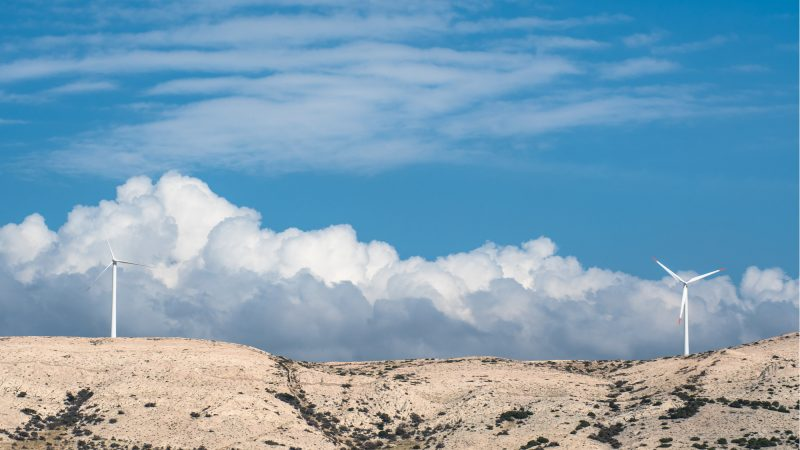 PAG ISLAND, CROATIA, OCTOBER 2020. Windmills on the island of Pag against sky and clouds. [Shutterstock/Vedrich]